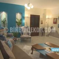 Mavi ve krem tonlarında dekore edilen salona şık ve modern bir hava ...
