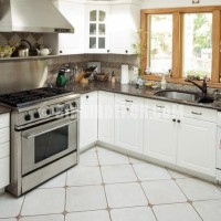 white kitchen design can help you achieve a bright, open cooking ...